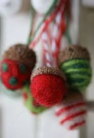 using cookie cutters to make needle felted ornaments great way to