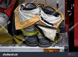 Firefighter Safety Boots by Firefighters Boots Pants On Fire Truck Stock Photo 34191202