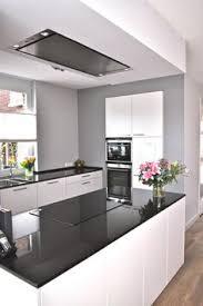 gray walls light wood floors white cabinets dark counter tops