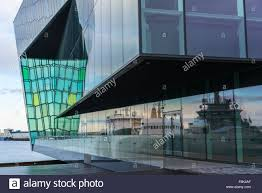 reflections of reykjavik fishing port boats in the glass walls of