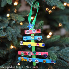 kid made sparkly craft stick tree ornament montessori