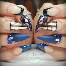 navy blue bronze and black stiletto nails with rhinestones