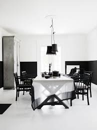 Black And White Home by Black Mahogany Wood Trestle Table With White Cushioned Chairs Of
