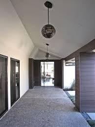 corbett lighting in entry midcentury with glass front door next to