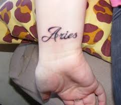 aries word tattoo on wrist tattoo designs tattoo pictures