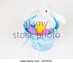 easter pail easter pail filled with toys eggs and candy isolated on a white