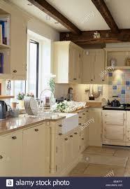 sink units for kitchens belfast sink below window in country cottage kitchen with cream