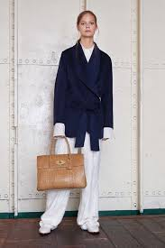 man holding martini mulberry resort 2016 collection vogue