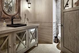 grey wooden bathroom vanity with rectangular black sink on grey