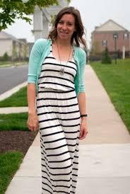 striped maxi dress worn with a black cardigan bright scarf