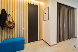 apartment yellow striped wall decor ideas and blue seatings with