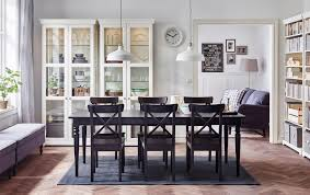 dining room furniture ideas ikea a large dining room with a black extendable dining table with chairs and glassdoor cabinets in