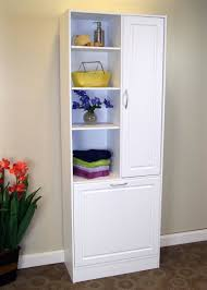 bathroom tall storage cabinet articles with tall bathroom cabinet with laundry basket tag