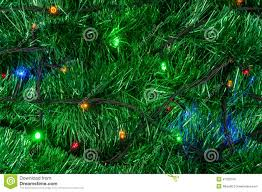 Christmas Garland With Lights by Christmas Garland Background With Colored Lights Stock Photo