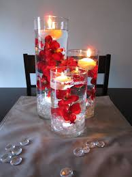 red orchid centerpieces love the floating candles would work