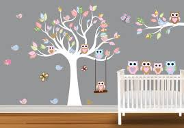 baby nursery wall decals of a pink tree on a white painted wall owls and a lovely tree wall decals on the wall of baby nursery with white cot