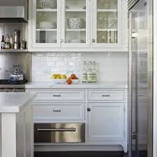 Kitchen Cabinet Glass Door by Love The Little Pops Of Green In With The Clean White Dishes For
