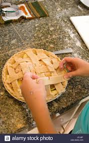 working on a apple pie for the thanksgiving day meal
