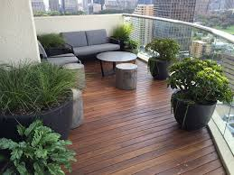outdoor furniture and potted plants on modern roof terrace stock
