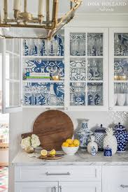 Blue Wallpaper On Back Of Glass KItchen Cabinets Transitional - Kitchen cabinet wallpaper