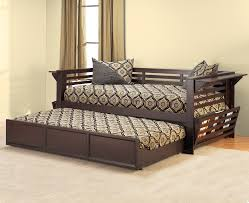 dark brown daybed with sliding bed having patterned sheet and
