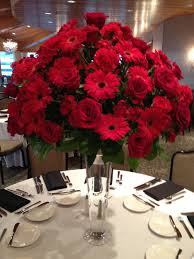centerpiece 22 inch pilsner vase topped with arrangement of red