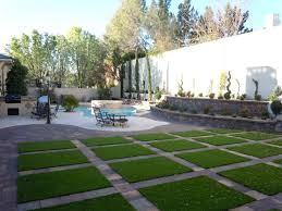 Fake Grass For Backyard by Artificial Grass And Pavers Are Quickly Becoming The Hottest New