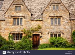 a typical cotswold stone country house with leaded lights mullion