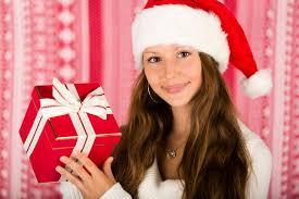 santa with a christmas gift free stock photo public domain