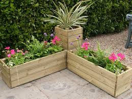 Garden Containers Ideas - plastic garden planters ideas with red orange and yellow color