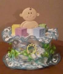 baby shower diaper cake table centerpiece and diaper cakes