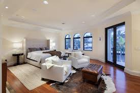 master bedroom with high ceiling hardwood floors in fort
