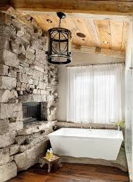 lodge inspired rustic bathroom with a stone wall and sheer