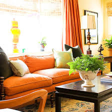 Living Room With Orange Sofa Decorating In Orange Sofa Covers Neutral And Linens