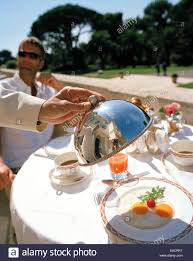 guest having breakfast at the bellini terrace hotel du cap eden