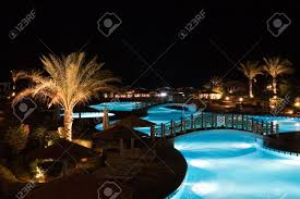 swimming pool at night stock photo picture and royalty free image