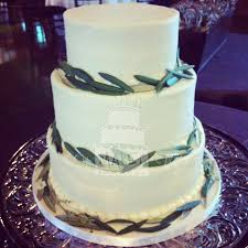 simple buttercream wedding cake with olive leaves