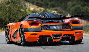koenigsegg orange lamborghini veneno owner buys one off koenigsegg agera xs
