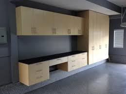 how to hang garage cabinets tan garage storage workbench on back wall garage ideas