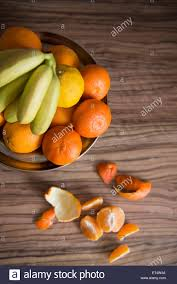 high angle view of fruit bowl of oranges and bananas on stock