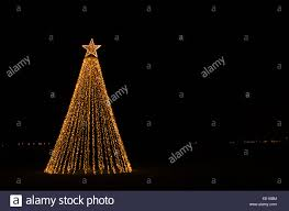 outdoor christmas illumination in form of a christmas tree with a
