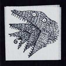 tim burton s napkin art compiled into a coffee table book the