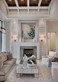 chic living room with white walls and wall sconces and mirrored