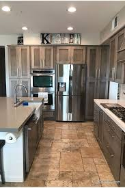gray stained kitchen cupboards this farmhouse modern kitchen features shaker cabinets in