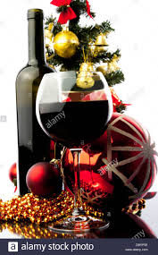 Christmas Tree Wine Bottles Wine Glass With Red Wine And Christmas Decoration Against White