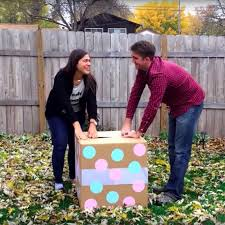 gender reveal balloons gender reveal party fail when box has rainbow balloons popsugar