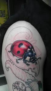 Ladybug And Flower Tattoos - powerline tattoo tattoos flower vine ladybug bio organic