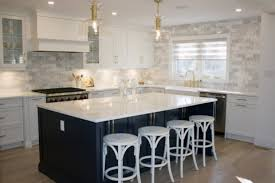 green kitchen cabinets with white island 21 quartz kitchen islands ideas to inspire your