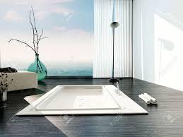 stylish sunken bath in a modern bathroom with large floor to