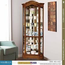 curved corner curio cabinet miller oak corner curio cabinet mirror back 680250 jamestown ii